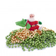 Santa Walking Over Green and Golden Beads — Stock Photo