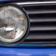 Close Up Of Old Blue Automobile Headlight And Grille — Stock Photo