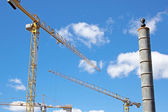Three Tower Crane Booms Against Blue Skyline — Stock Photo