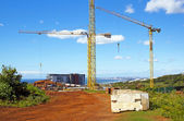 Construction Site With Three Tower Crane Booms Against Blue Skyline — Foto Stock