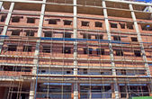 Scaffolding Erected Around Brick And Concrete Building Under Con — Stock Photo