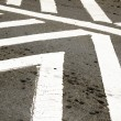 Stock Photo: White Painted PedestriCrossing On Tarmac Roadway