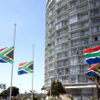 South African Flags Flying At Half-Mast — Stock Photo