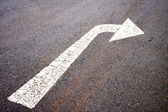 White Painted Arrow Indicating Left Turn On Asphalt Surface — Stock Photo