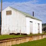 Dilapidated Corrugated Iron Storage Shed Alongside Railway track — Stock Photo #38037675
