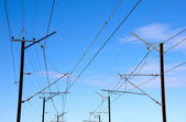 Overhead Power Lines Providing Power To Electric Trains — 图库照片