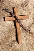 Wooden Cross and Thorns on Sand Background — Stock Photo