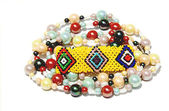 Isolated Colorful Beaded Bracelet and Necklace on White — Stock Photo