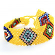 Stock Photo: Colorful Woven Beaded Zulu Wrist Band Bracelet on White