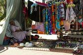 Elderly Woman Asleep in Colorful Sreet Vendor Stall — Stock Photo