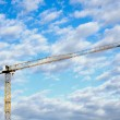 Yellow Tower Crane Against Blue Cloud Sky — Stock Photo #42800633