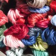 Collection of Multi Colored Skeins of Embroidery Cotton — Stock Photo #42889565
