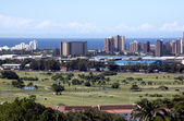City Skyline With Golf Course and Ocean — Stock Photo