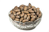 Unshelled Pecan Nuts in Decorative Glass Bowl — Stock Photo
