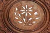 Center Ornate Marketry on Wooden Carved Table  — Stock Photo