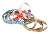 Three Tape Measures Marked in Inches and Centimetres — Stock Photo