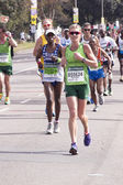 Woman in Green Running the Comrades Marathon — Photo