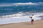 Fisherman Fishing Off Blue Lagoon Beach in Early Morning — Stock Photo