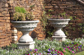 Two Urn Flower Pots in Garden Setting  — Stock Photo