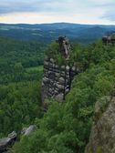 Summer evening before storm in Saxon Switzerland, grey sky over sandstone rocks. Attractive destination for tourists and climbers. — Stock Photo