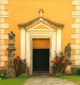 Old side door into church from sixteenth century. Renewal wall with new paint. — Stockfoto