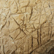 Defected lime stone. Yellow stone with scratches, holes, veins, marks. — Stockfoto
