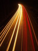 Car light trails bellow highway bridge. Long exposure photo taken from the bridge.. — Stock Photo