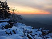 Winter morning view to East with orange sunrise. Daybreak in rocks of Bohemian-Saxon Switzerland park. — Stock Photo