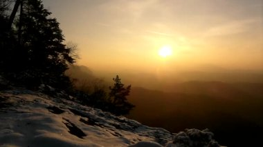 Windy winter morning view to East with orange sunrise. Daybreak in rocks — Stock Video
