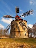 Renewal wind mill house into summer house. New red roof, repaired wind blades. — Stock Photo