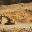 Big black orange digger in open sand mine is waiting for new shift. — Stock Photo #45915937