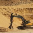 Big black orange digger in open sand mine is waiting for new shift. — Stock Photo #45915945