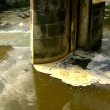 Turning of dirty water above weir on small river with muddy water. Stony wall of weir — Stock Video