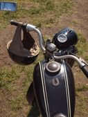 """Handlebars with mirror and helmet on vintage motorcycle made in the sixtieth. Czech public motorcycle on """"The old timer show"""". — Stock Photo"""