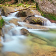 Stock Photo: Mountain river in spring. A stream of water in forest and mounta