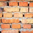 Old brick wall. Rough burnt crooked old red brick wall. — Stock Photo