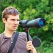 Mwith spotting scope. — Stock Photo #35284949