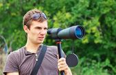 Man with spotting scope. — Stock Photo