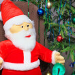 Toy santa claus near a Christmas tree — Stock Photo