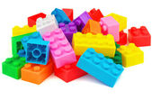 Plastic building colorful toy blocks on white background — Stockfoto