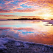 Winter landscape with lake and sunset fiery sky. Composition of  — Stock Photo