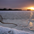 Winter landscape with frozen lake, snag and sunset sky — Foto Stock
