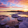 Winter landscape with lake and sunset fiery sky. — Stock Photo #37765777