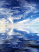 Sky background. Element of design. Sky and reflection in water — Stock Photo