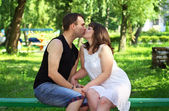 Young beautiful couple. Summer green park  — Stock Photo