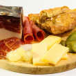 Stock Photo: Cheese and meats with cucumber and grapes