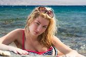 Beautiful girl on the sea — Stock Photo