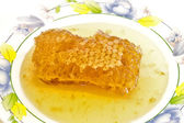 Fresh honey with honeycomb . — 图库照片