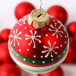 Red Christmas ball with snowflake, dots and stripes — Stock Photo #29554855