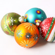 Set of four colorful Christmas balls on white background — Stock Photo